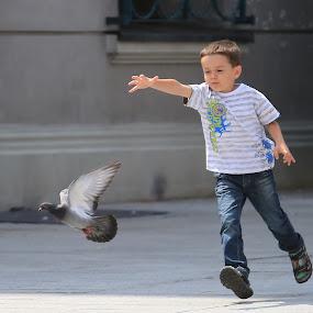 Come here birdie. by Ron Russell - Babies & Children Children Candids
