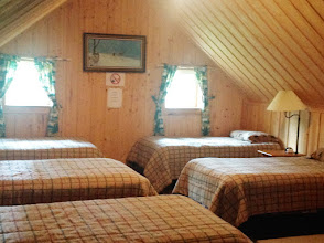 Photo: Cabin 3 upstairs bedroom view.  Can be turned into king beds. Full bathroom and kitchen downstairs (not pictured).