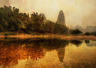 """Photo: The Unknown Land - Li River, China   After a while, my boat driver thought I was insane.  We started before the sunrise and kept going, and going, and going, and going... he kept giving me the international head movement for """"we really should be returning for a spot of tea,"""" but I kept motioning him further up the river.  To me, the river got most interesting when we saw no more people, except for the occasional fisherman that still had remote hut for his family along the river.  I had plenty of battery power, amazing music on my iPod, a full array of snacks, a ton of drinks, and nothing to do for the rest of the day and night... so I was perfectly content just going until our gas tank reached 50%.  And that took a long time... and who would want to stop with views like this around every other turn?  from the blog www.stuckincustoms.com"""