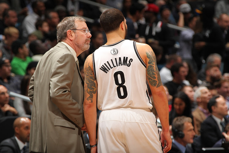 Photo: Head Coach P.J. Carlesimo of the Brooklyn Nets talks with Deron Williams #8 during a break in play against the Toronto Raptors at the Barclays Center on January 15, 2013 in the Brooklyn borough of New York City in New York City.