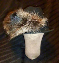 Photo: <KAPELUXE> Unique-Chique Hats by Luba Bilash ART & ADORNMENT  Midnight black wool felt fedora; black grosgrain band; fox tail 360 degree possibilities. Can also be worn on an angle. Size L - 56 cm/22 in SOLD