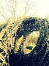 """Photo: Old-fashioned photo of """"A Wiggle in Its Walk,"""" a woven wooden structure by Patrick Dougherty at Wegerzyn Gardens in Dayton, Ohio."""
