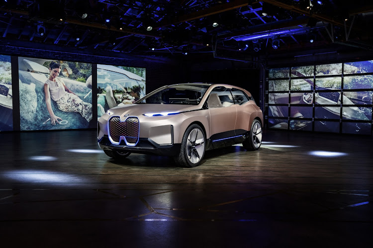 "The signature BMW kidney grille swells to dramatic proportions. With no engine to cool in the electric vehicle, the blanked-off grille now serves as an ""intelligence panel"" fitted with sensors required for self-driving capability. Picture: SUPPLIED"