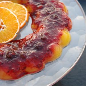 Orange pudding (no eggs) with Raspberry Sauce