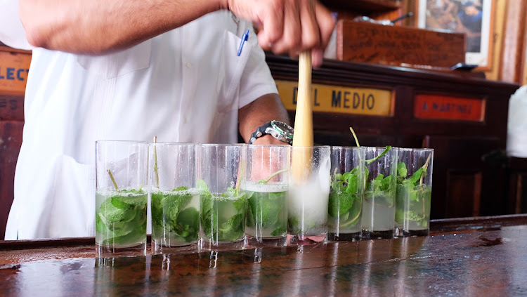 Muddler at the ready, making Hemingway's favourite Mojito at La Bodeguita Del Medio.