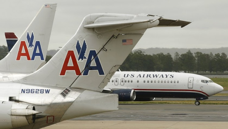 US Airways and American Airlines aircraft pass each other at Ronald Reagan National Airport in Virginia, the US. Picture: REUTERS