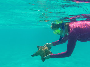 Photo: Anne with starfish off Bond Cay, Berry Islands