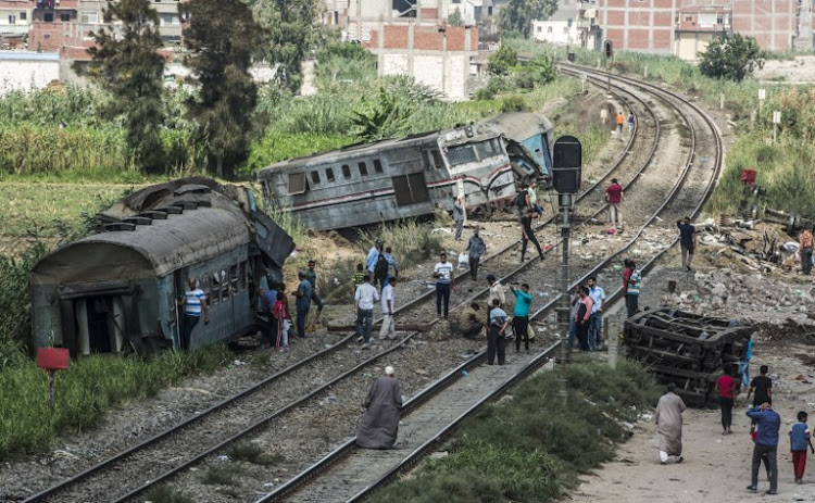 A general view of people observing the wreckage of a fatal train collision in the area of Khorshid on the outskirts of Egypt's Mediterranean city of Alexandria.