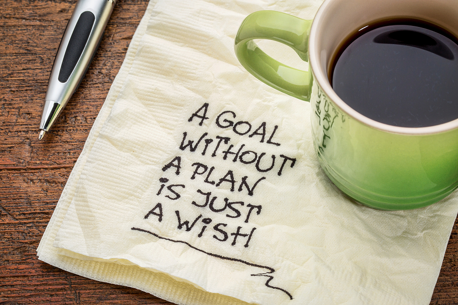 Napkin with writing on it that says a goal without a plan is just a wish
