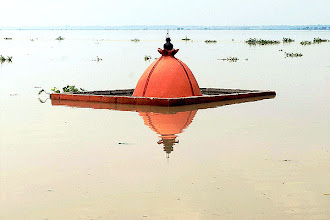 Photo: A submerged temple at Sangam in Allahabad after rise in the water level of Ganga & Yamuna rivers. (PTI)
