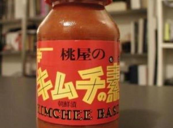 In a salad bowl, mix vinegar, lemon, salt, sugar, kimchee base sauce and black...