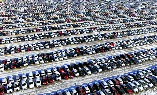 New cars in a parking lot in Shenyang, Liaoning province, China. Picture: REUTERS