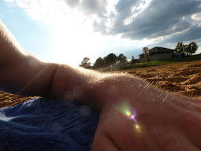 Photo: Laying in the warm sand after a round of swimming.