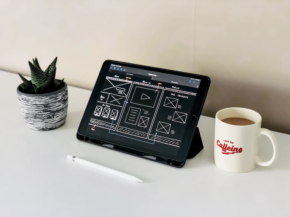 drawing tablet, plant, and coffee