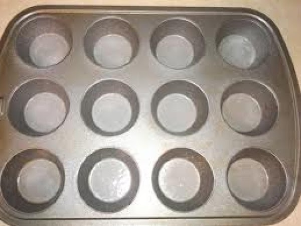 Spray each hole in the cupcake pan lightly with non stick spray.