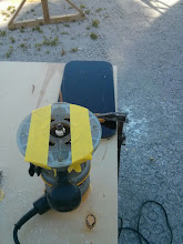 Photo: masking tape on base of router to prevent scratching new window while using a round over bit to radius the edges