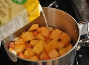 Add spices and 1-1/2 cup chicken broth, jalapeno, squash and simmer till squash is...