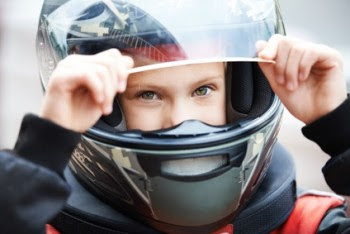 Boy wearing karting helmet