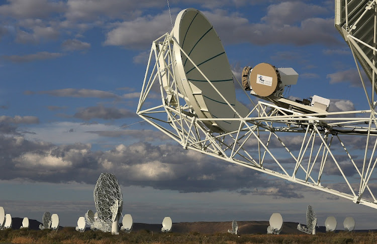 Radio telescopes dot the landscape at the MeerKAT installation in the remote Northern Cape. Picture: RUVAN BOSHOFF/SUNDAY TIMES