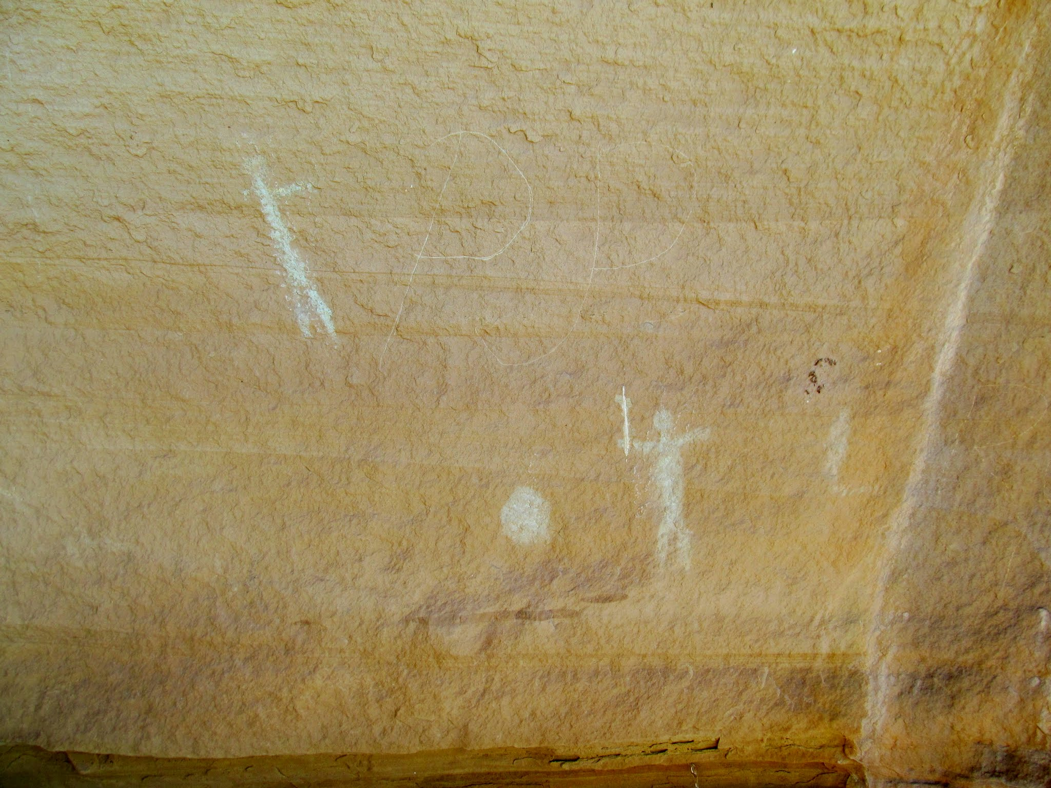 Photo: Greenish-white pictographs and a PJP inscription
