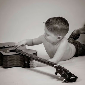 Playing with daddy's guitar by Stephanie Halley - Babies & Children Children Candids ( child, guitar )