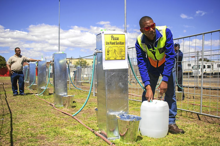 Brandon Herringer, a City of Cape Town plumber, demonstrates one of the water points Cape Town residents will use when 'day zero' arrives on April 22. File photo.