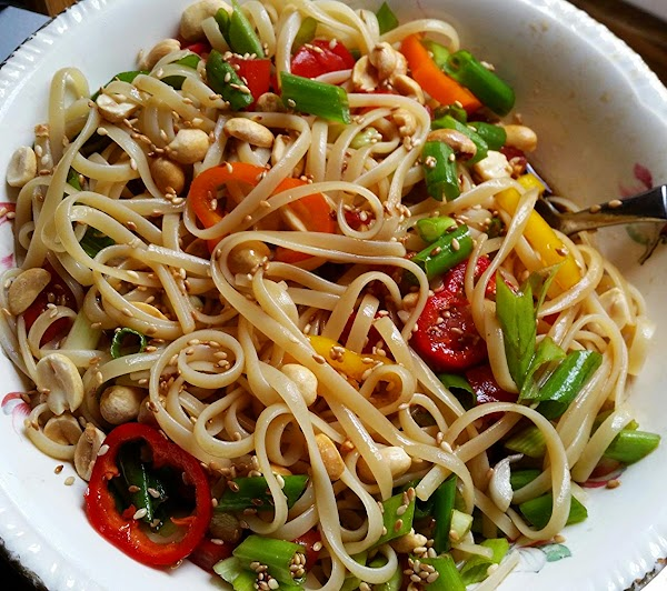 When serving, sprinkle with sesame seeds and nuts. If not using right away, cover...