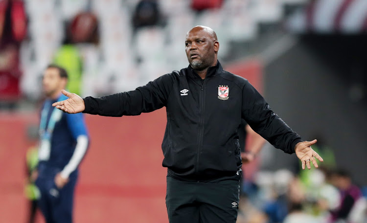 Al Ahly coach Pitso Mosimane reacts during a match at the Education City Stadium, in Al Rayyan, Qatar.