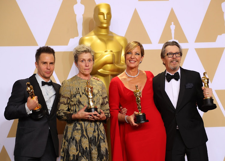 Oscar winners Sam Rockwell, Frances McDormand, Allison Janney and Gary Oldman pose backstage at the awards ceremony on March 4 2018. Picture: REUTERS