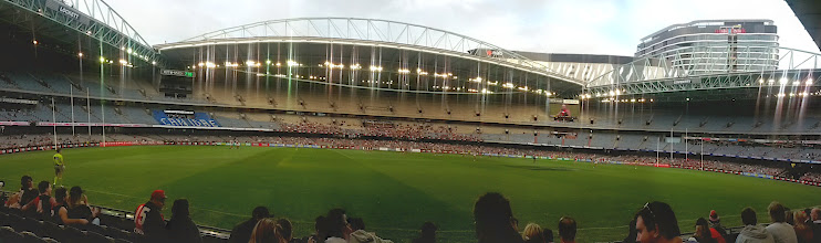 Photo: Saw our first Aussie rules footy game.  The stands are mostly empty because it's preseason.  We rooted for the hometeam, Essendon, but it didn't help.