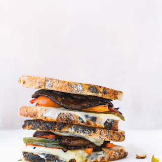 Marinated Portobello Mushroom Sandwich with Grilled Bell Pepper, Melted Gruyere cheese, and Mozzarella..