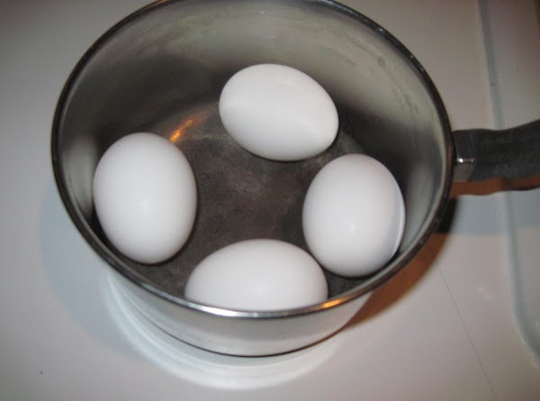 Set the eggs to hard boil.  I put the eggs in a small...