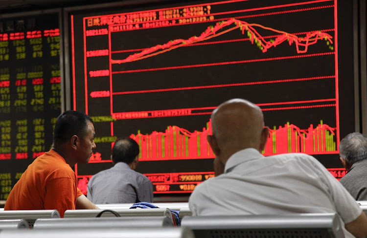 A board in Beijing shows stock prices on the Shanghai Securities Exchange on Wednesday. The Chinese government froze stock markets amid a dramatic correction last month. File Picture: REUTERS