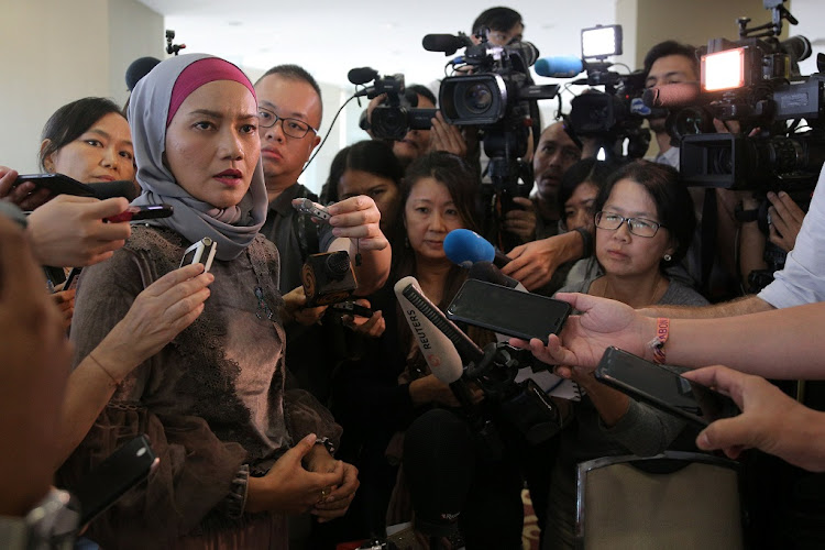 A family member speaks to the media after an MH370 briefing closed door meeting in Putrajaya, Malaysia, July 30 2018. Picture: REUTERS/ SADIQ ASYRAF