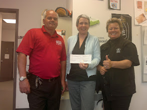 Photo: Roger Pattison and Banan Pattison present the donation cheque from the BBQ fundraiser to Cheryl Colmer (centre).