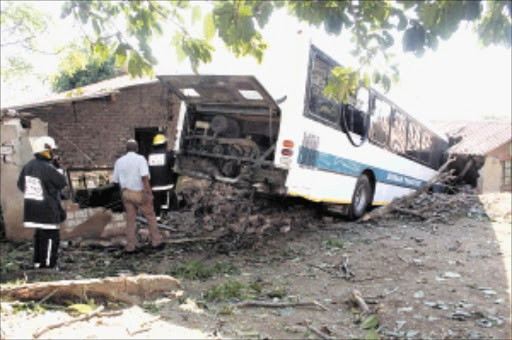 STUCK: A metro bus driver lost control of his bus and crashed into two houses after he allegedly suffered an epileptic fit or mild stroke. Pic:  Thuli Dlamini. Circa May 2010. © Sowetan.