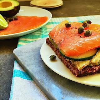 Smoked Salmon and Avocado Tartine on Rye Bread.