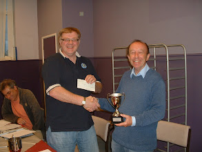 Photo: Trowbridge player Roy Ludlow receives the 2010-11 Wiltshire Open Chess Championship Minor Champion Trophy from Johnathon Bourne.