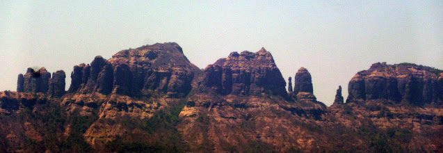 Photo: Bhatoba Pinnacle is the large bell shaped pinnacle just right of center. Mahuli Fort is on top of the right-most buttress.