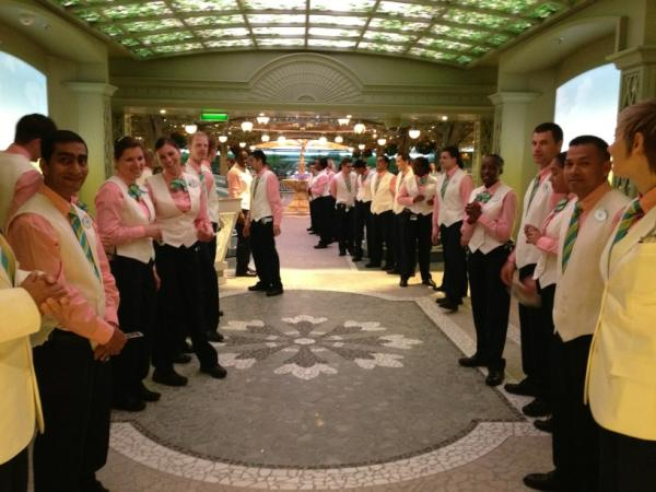 Photo: The staff at Enchanted Garden provide a warm welcome to dinner guests aboard the Disney Fantasy.
