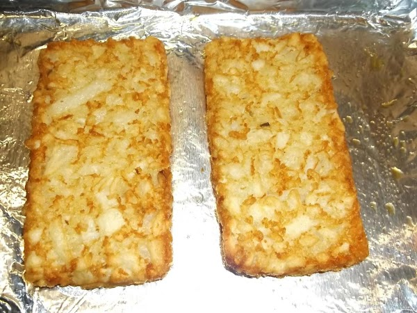In toaster oven or regular oven, bake hash brown patties according to package instructions....