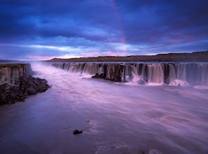 Photo: The destination was surely worth the hassle, two beautiful and loud waterfalls Selfoss and Detifoss suddenly put us on a bright side of the hell. I felt like the first man on the Moon. Millions years back in time. We arrived just before the sunset (that's around 11pm in Iceland during the summer), the place was of course deserted. We were stupid enough to underestimate the pace with which the natural powers change the stage we're living on. Leaving our equipment behind, we missed perhaps the most spectacular light performance I witnessed there – the sun found its way through thick clouds to illuminate parts of the scene and to create the stunning rainbow.  Some more here: http://www.landandcolors.com/2012/02/the-essence-of-selfoss/
