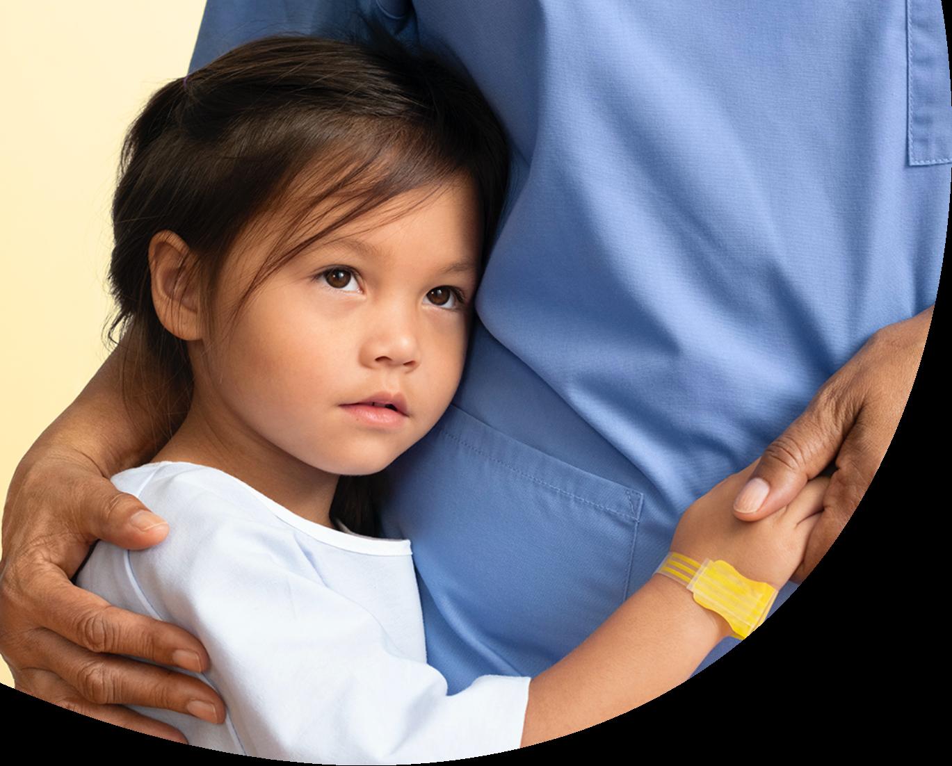 Child hugging provider