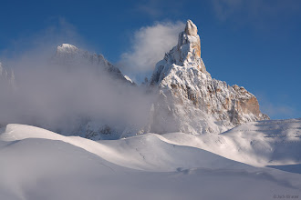 Photo: Later afternoon light on snowy Cimon della Pala, as storm clouds clear off - December.