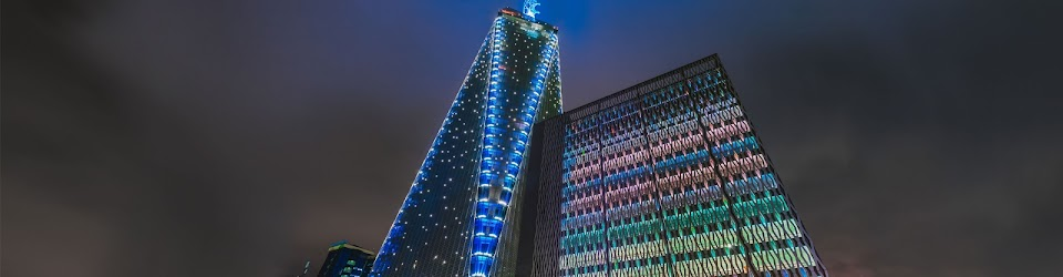 Colorfully lit-up sky scraper at night