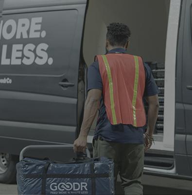 Goodr employee loads food into waiting truck
