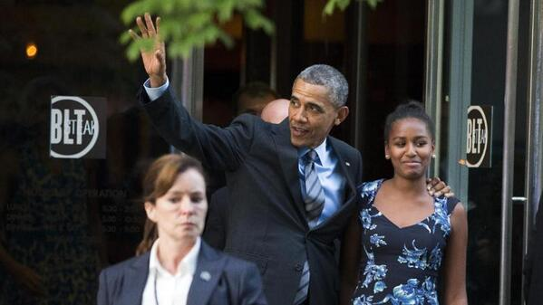 Former President Obama and First Daughter Sasha exit BLT.