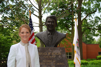 Photo: Corrie Heck '06 in the Ronald Reagan Peace Garden at Eureka College