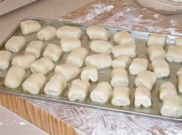 Placed gnocchi on a floured cookie sheet. Flour and add sheets of wax paper...