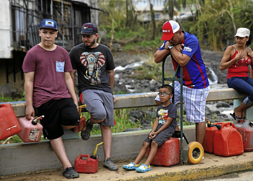Residents affected by Hurricane Maria queue for fuel donated by the Fuel Relief Fund in the municipality of Orocovis, outside San Juan, Puerto Rico, on October 10 2017. Picture: REUTERS